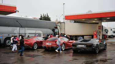 Kids looking at supercars - Ferrari F12 v Lamborghini Aventador and Aston Martin V12 Vanquish