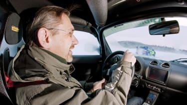 John Barker at the wheel