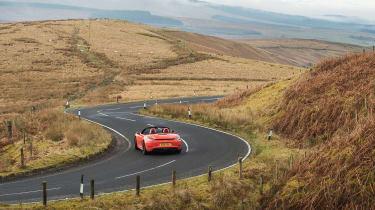 Porsche 718 Boxster S - moving rear]