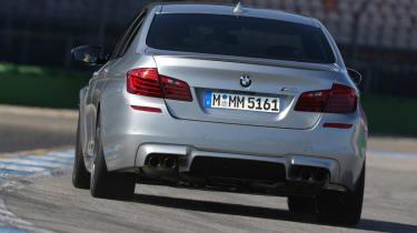 BMW M5 2013 rear cornering, on track