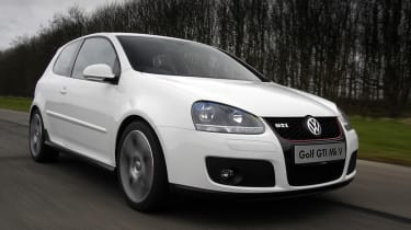 VW Golf GTI mk5 driving, white