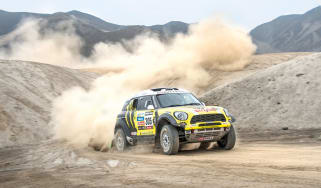 Mini riding the sand dunes on the Dakar rally