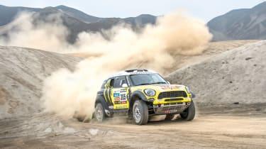 Mini riding the sand dunes on the Dakar rally