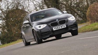 BMW M135i black five-door drift
