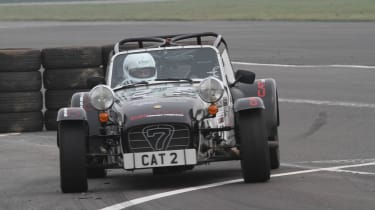 evo sprints a Caterham at Silverstone