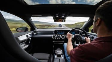 Hot hatchback triple – interior driving AMG