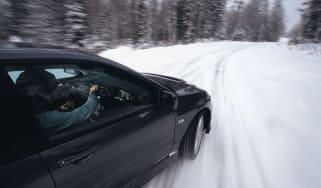 Rallying in the snow in a Mitsubishi Evo IX