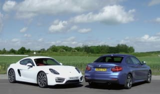 Porsche Cayman v BMW M235i track battle
