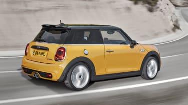 2014 Mini Cooper S yellow driving