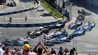 Sebastien Buemi gets held up in the melee at the first corner