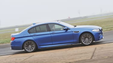 BMW M5 blue, on track action