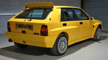 Lancia Delta Integrale Evo yellow rear spoiler up