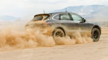 Porsche Macan SUV dust trail
