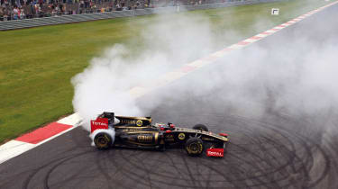 Lotus F1 car doing a burnout