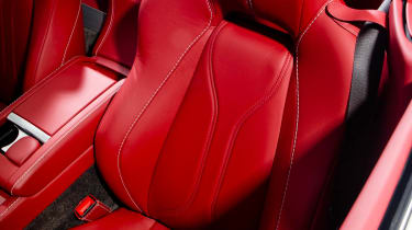 Aston Martin V12 Vantage Roadster red leather sports seat