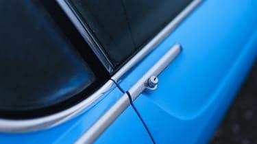 Volvo P1800 Cyan Racing – door handle