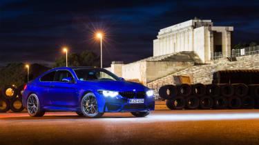 A blue BMW M parked
