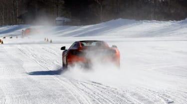 McLaren MP4-12C orange driving on snow
