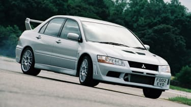 Mitsubishi Lancer Evolution VII - press shot yellow