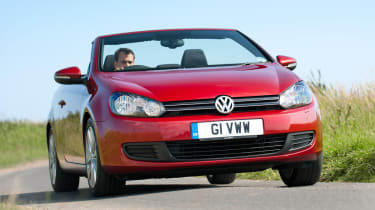 VW Golf TDI Cabriolet red roof down
