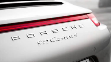 Porsche 911 Carrera 4 rear badge red strip