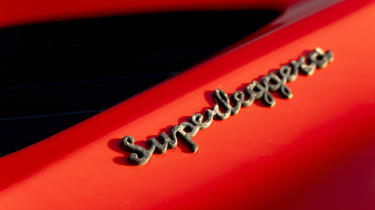 Aston Martin DBS Superleggera Volante badge
