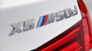 BMW X5 M50d rear badge