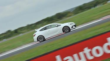 2012 Vauxhall Astra VXR white on track