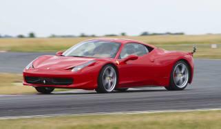 Red Ferrari 458 Italia sliding on track