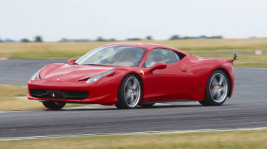 Red Ferrari 458 Italia sliding on track