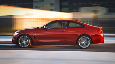 New BMW 4-series coupe red side profile