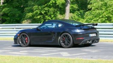 Porsche 718 Cayman GT4 on track - rear quarter