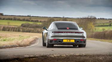 Porsche 911 Carrera vs Lotus Evora GT410 – rear slide