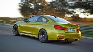 New BMW M4 yellow rear