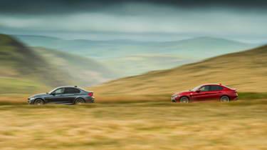 BMW M3 Competition Package & Alfa Romeo Giulia Quadrifoglio – side on road