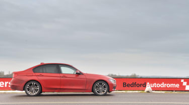 BMW 320d m sport side profile red