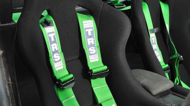 Revolution Project STI Nurburgring Subaru Impreza front seat green harnesses