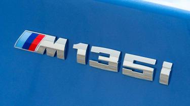 2012 BMW M135i badge