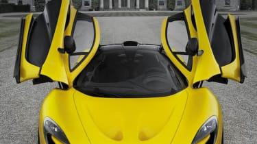 McLaren P1 doors up Goodwood house