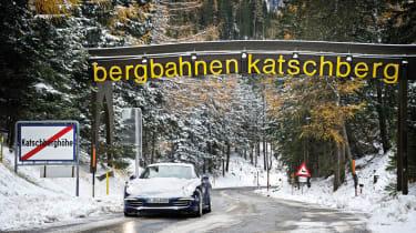 Porsche 911 Carrera 4S driving on snow covered Alpine roads