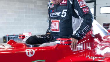 Michael Schumacher's Ferrari F1 car Richard Meaden climbs in
