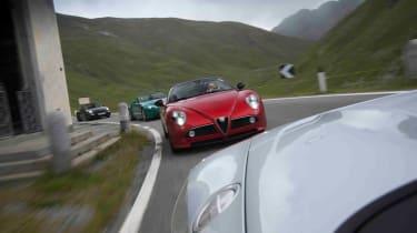 Alfa Romeo 8C Spider v Audi R8 Spyder v Aston Martin Vantage S Roadster v Porsche 911 Carrera GTS cabrio video