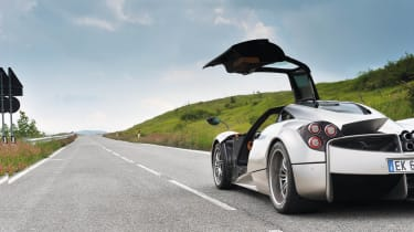 Pagani Huayra in the Italian hills door up horizon