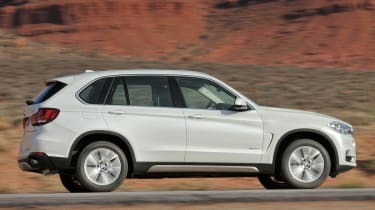 New 2013 BMW X5 white side profile