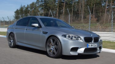 BMW M5 2013, driving on track, facelift