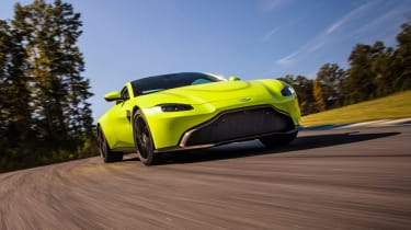 evo exclusive Aston Martin Vantage - green driving front quarter