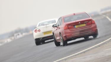 BMW 320d sideways drift on track red f30