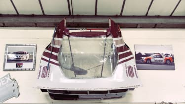 IMSA Ford RS200 rear clamshell – complete with near-vertical spoiler – hangs on the workshop wall