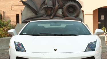 Lamborghini Gallardo LP550-2 in front of statue