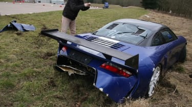 crashed 9ff GT9R rear with bloke